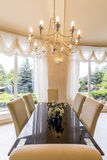 Elegant dining room with chandelier Stock Photo