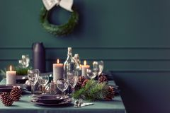 Elegant dining room table with wine glasses, plates and candles set for christmas dinner. Elegant dining room table with wine glasses, plates and candles set for royalty free stock photos