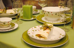 Elegant dining setting. An elegant dining setting in green stock photos