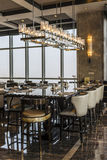 Elegant dining setting with high chairs and good view at Wanda hotel Royalty Free Stock Image