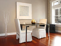 Elegant dining table set in a modern living room Royalty Free Stock Photos