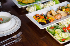 Elegant dinner buffet with soup, fish and vegetables Royalty Free Stock Images