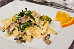 Tagliatelle pasta dish with broccoli and mushrooms Stock Photos