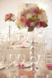 Elegant dinner table with beautiful flower decorations Stock Photo