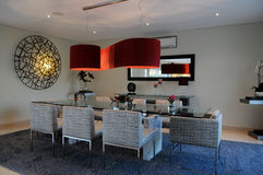 Elegant Dinning Space with Red Ceiling Lampshade Stock Photography