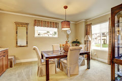 Elegant dinning room with carpet and table. Royalty Free Stock Photography
