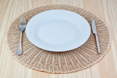 Elegant dish fork knife on braided cloth. Royalty Free Stock Photography