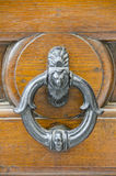 Elegant Door Knocker in Cortona, Italy. An elegant round door knocker adds a touch of charm to this front door in Cortona, Italy Stock Photography