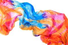 Elegant draped cloth. Orange and blue fabric texture background. Royalty Free Stock Images
