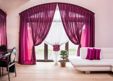 Elegant drapes and curtain. Big window with elegant drapes and curtain Stock Images