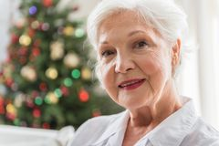Elegant elderly woman is expressing positiveness stock images