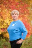 Elegant elderly woman portrait, autumn day. Royalty Free Stock Photo