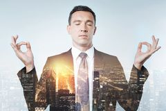 Elegant employer being in harmony with his thoughts Royalty Free Stock Photography