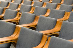 Elegant empty grey chairs neatly ordered in several rows Stock Image
