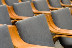 Elegant empty grey chairs neatly ordered in several rows Royalty Free Stock Photo