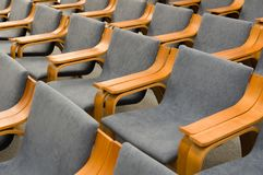 Elegant empty grey chairs neatly ordered in several rows Royalty Free Stock Image