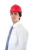 Elegant engineer with red helmet Royalty Free Stock Image