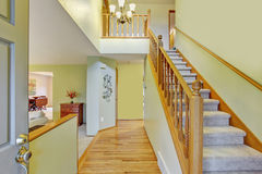 Elegant entry way with stairs. Royalty Free Stock Image
