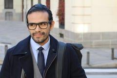 Elegant ethnic businessman walking outdoors.  stock image
