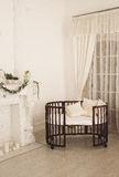 Elegant expensive bed for newborn baby. Luxury decorations of apartments Stock Image