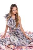 Elegant fashion blond girl in flower dress. Stock Image