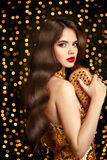 Elegant Fashion Brunette Woman. Wavy Hair Style. Red Lips Makeup