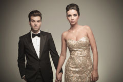 Elegant fashion couple holding hands Stock Photo