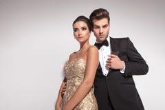 Elegant fashion couple posing on grey studio background Stock Photography