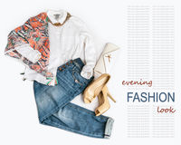 Elegant fashion evening  look with jeans on white background Stock Image