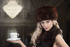 Elegant fashion lady with cup of tea Stock Photo