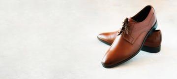Elegant fashion male shoes on gray background. Sale and shopping concept. Elegant fashion male shoes on gray background. Sale and shopping concept Stock Photos