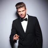 Elegant fashion man in tuxedo enjoying his cigar Royalty Free Stock Photo