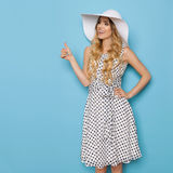Elegant Fashion Model In Summer Dress And Sun Hat Is Showing Thumb Up stock images