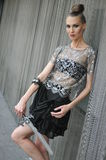 Elegant fashion model wearing couture clothes and holding swart Royalty Free Stock Photo