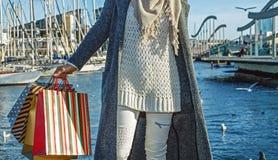 Elegant fashion-monger on embankment in Barcelona, Spain Stock Images