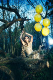 Elegant fashion woman with balloons  in forest Stock Photos