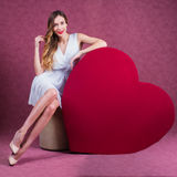 Elegant and fashion woman holding heart Stock Photography