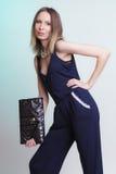 Elegant fashion woman with leather handbag Royalty Free Stock Images