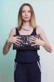 Elegant fashion woman with leather handbag Stock Photo