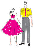 Elegant  fashion woman and man. Young sexy woman in a vintage dress and a young man, dressed in the style of 50-ies Royalty Free Stock Image