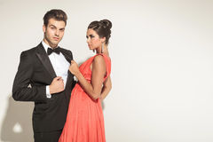 Elegant fashion woman pulling her lovers tuxedo Stock Photos