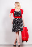 Elegant fashion woman with red suitcase Royalty Free Stock Image