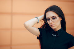Elegant Fashion Woman with Trendy Eyeglasses and Pearl Accessories Stock Photo