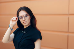 Elegant Fashion Woman with Trendy Eyeglasses and Pearl Accessories Royalty Free Stock Photo