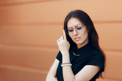 Elegant Fashion Woman with Trendy Eyeglasses and Pearl Accessories Royalty Free Stock Photography