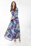 Elegant Fashionable Female in Silky Blue Flowery Dress Stock Image