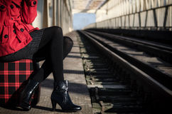 Elegant fashionable lady waiting for the train Royalty Free Stock Image