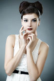 Elegant fashionable woman with a bow hairstyle Stock Photography