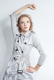 Elegant fashionable woman in a gray coat Royalty Free Stock Image