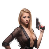 Elegant fashionable woman with a gun in hands Stock Images